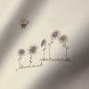 lenzuola per lettino colore greggio naturale con ricamo fiori blu